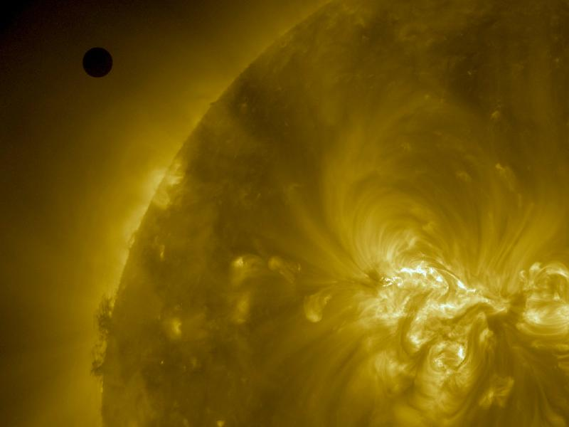 Venus transiting sun from satellite